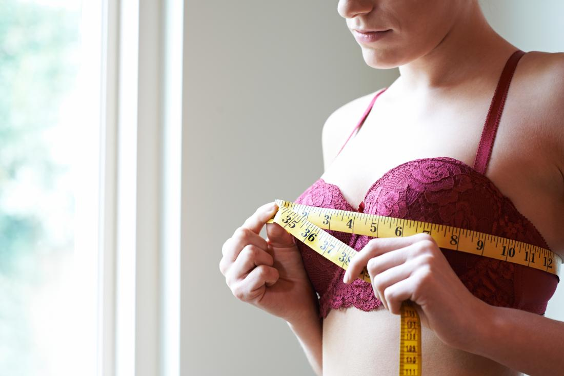What causes breasts to stop growing